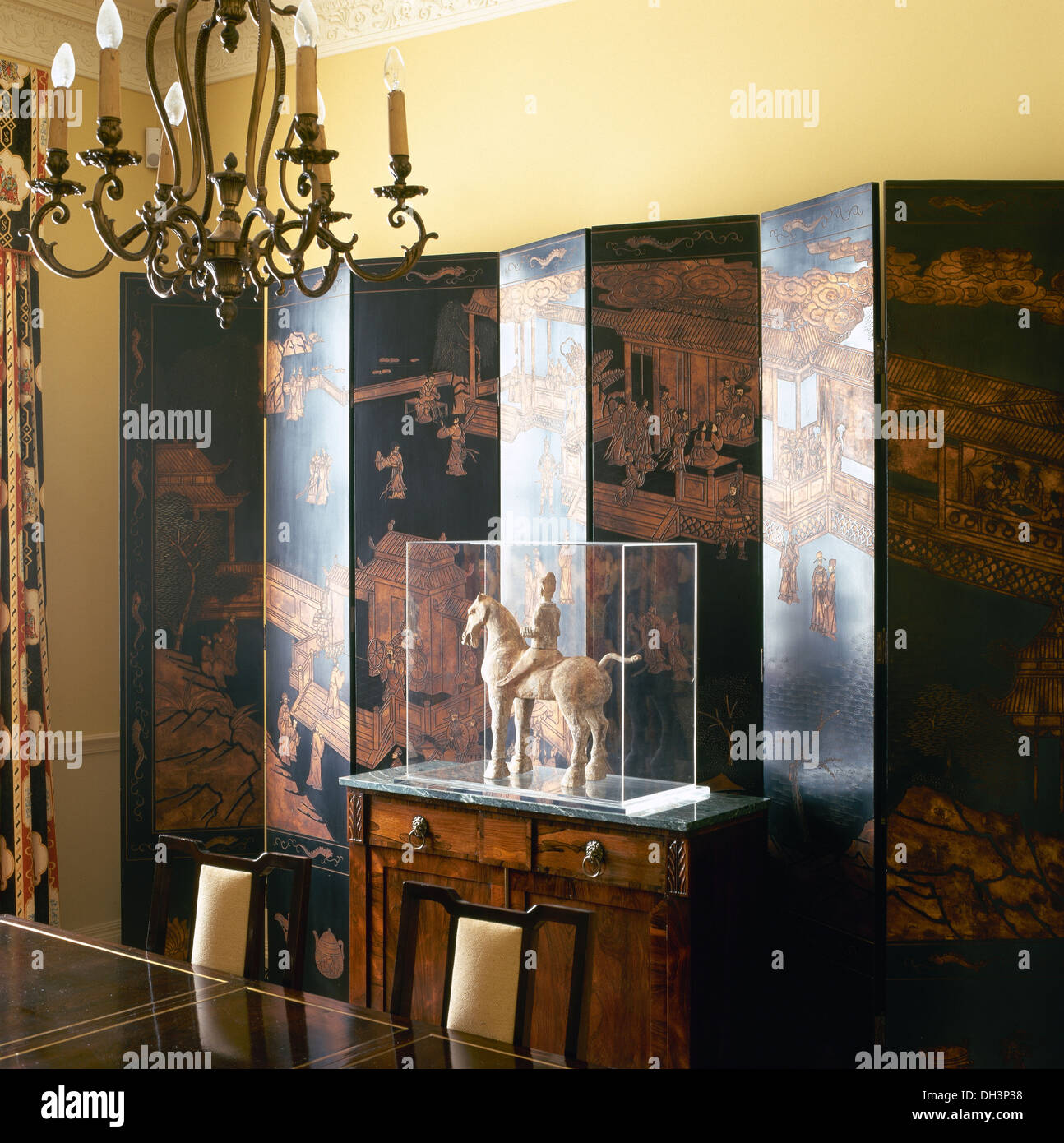 Dining Room With Oriental Statue Of Horse And Rider In Glass Case On Cabinet Front Antique Chinese Folding Screen