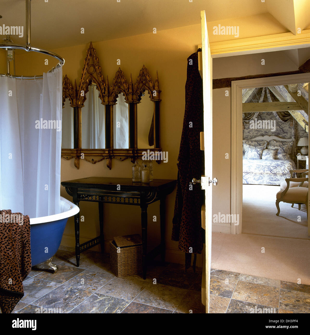 Gothic Style Mirror Above Metal Table In Bathroom With Shower Curtain On Circular Frame Roll Top Bath Country