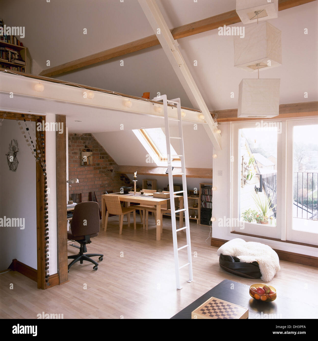 Small Loft Furniture Pale Wood Dining Table And Chairs In Small Loft Conversion With