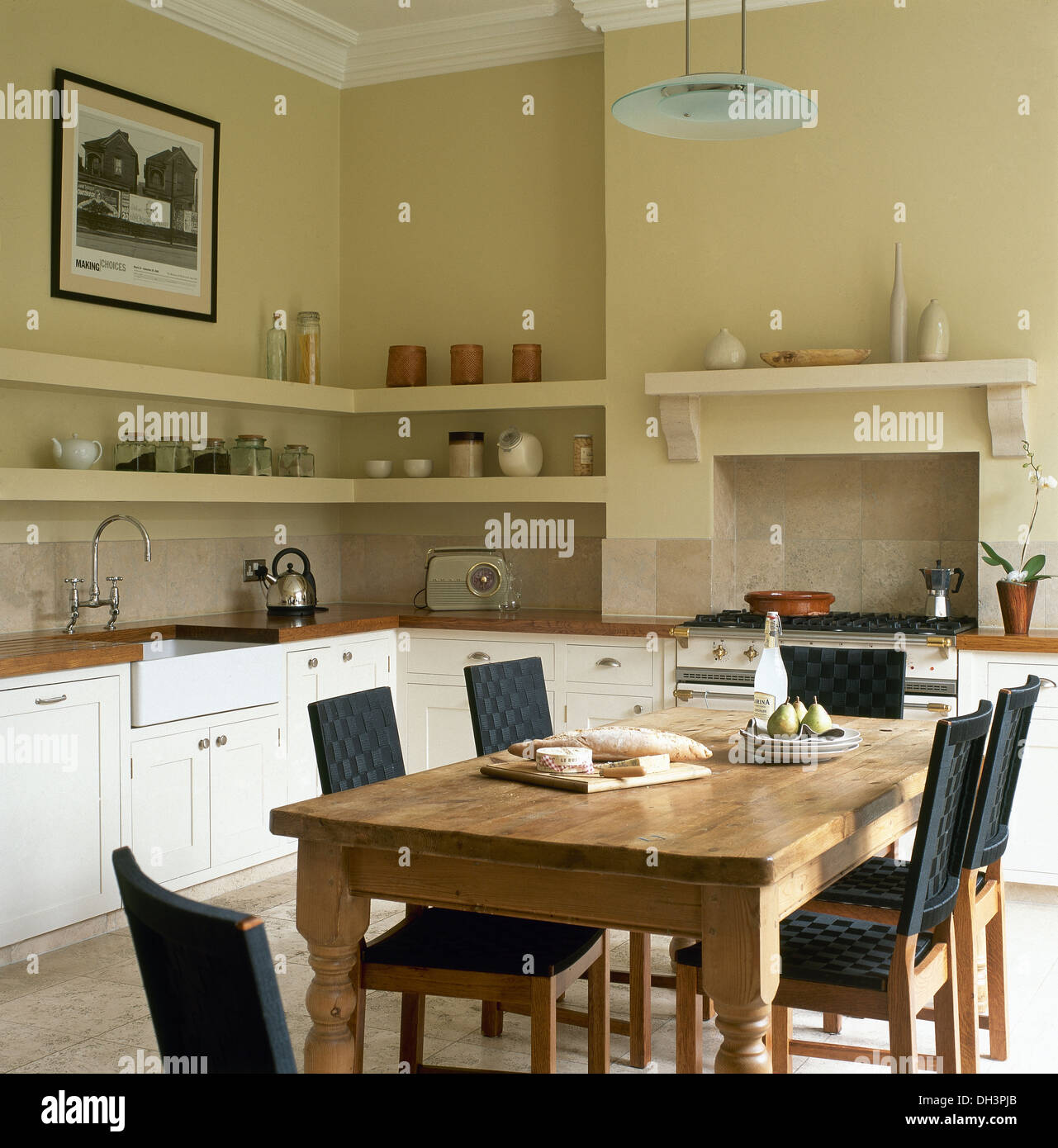 Pine Table And Chairs With Black Seats And Backs In Cream