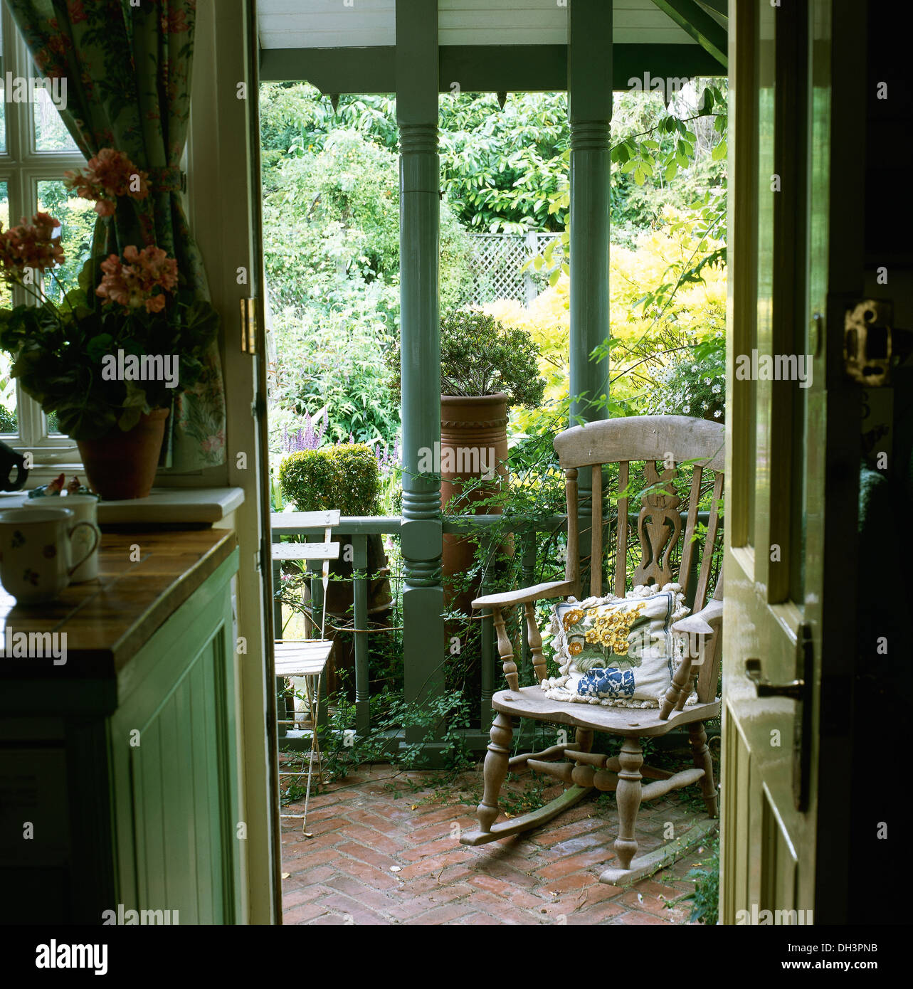 Country Kitchen With Open Door And View Of Rocking Chair