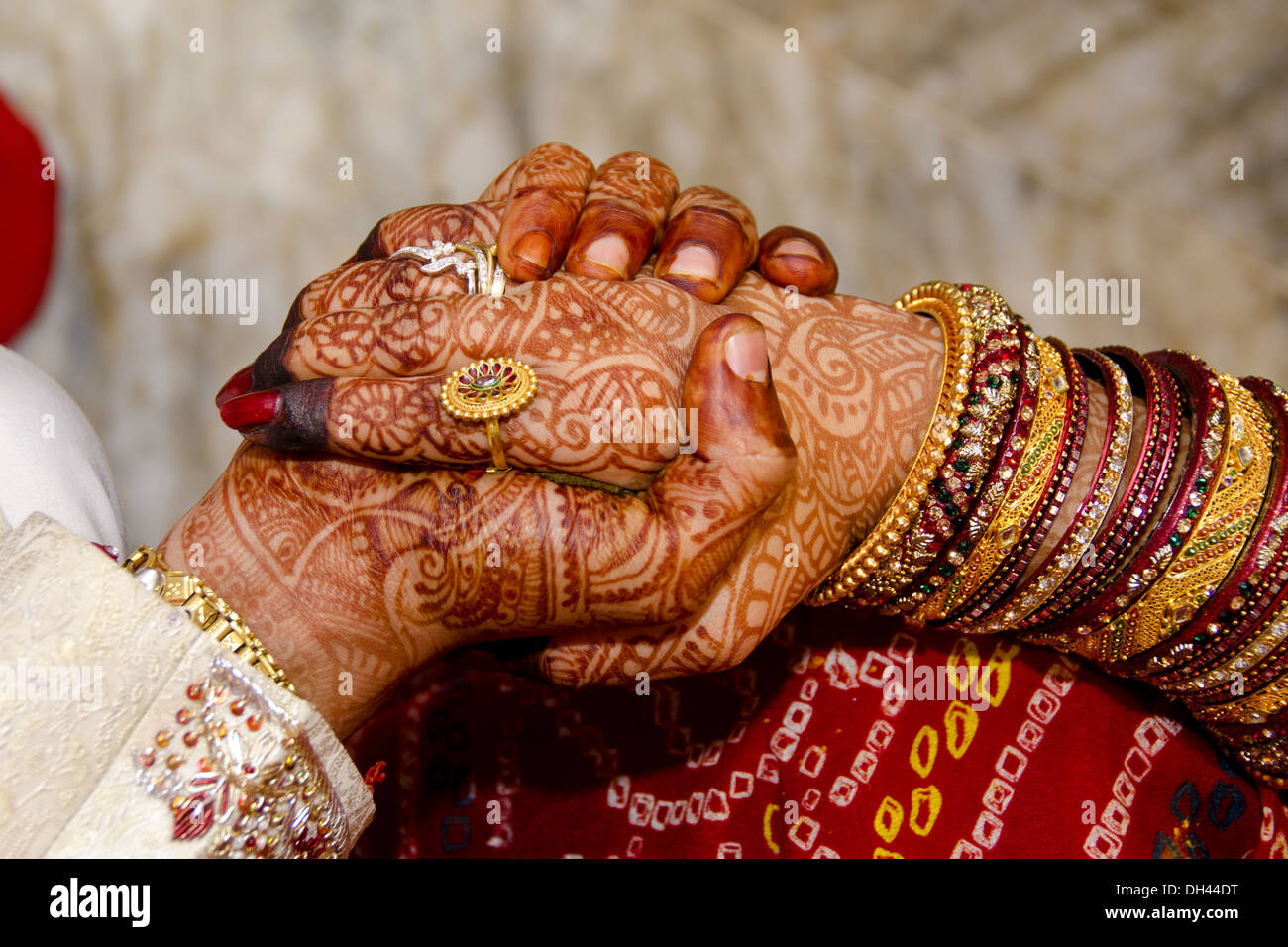 Punjabi wedding couples holding hands