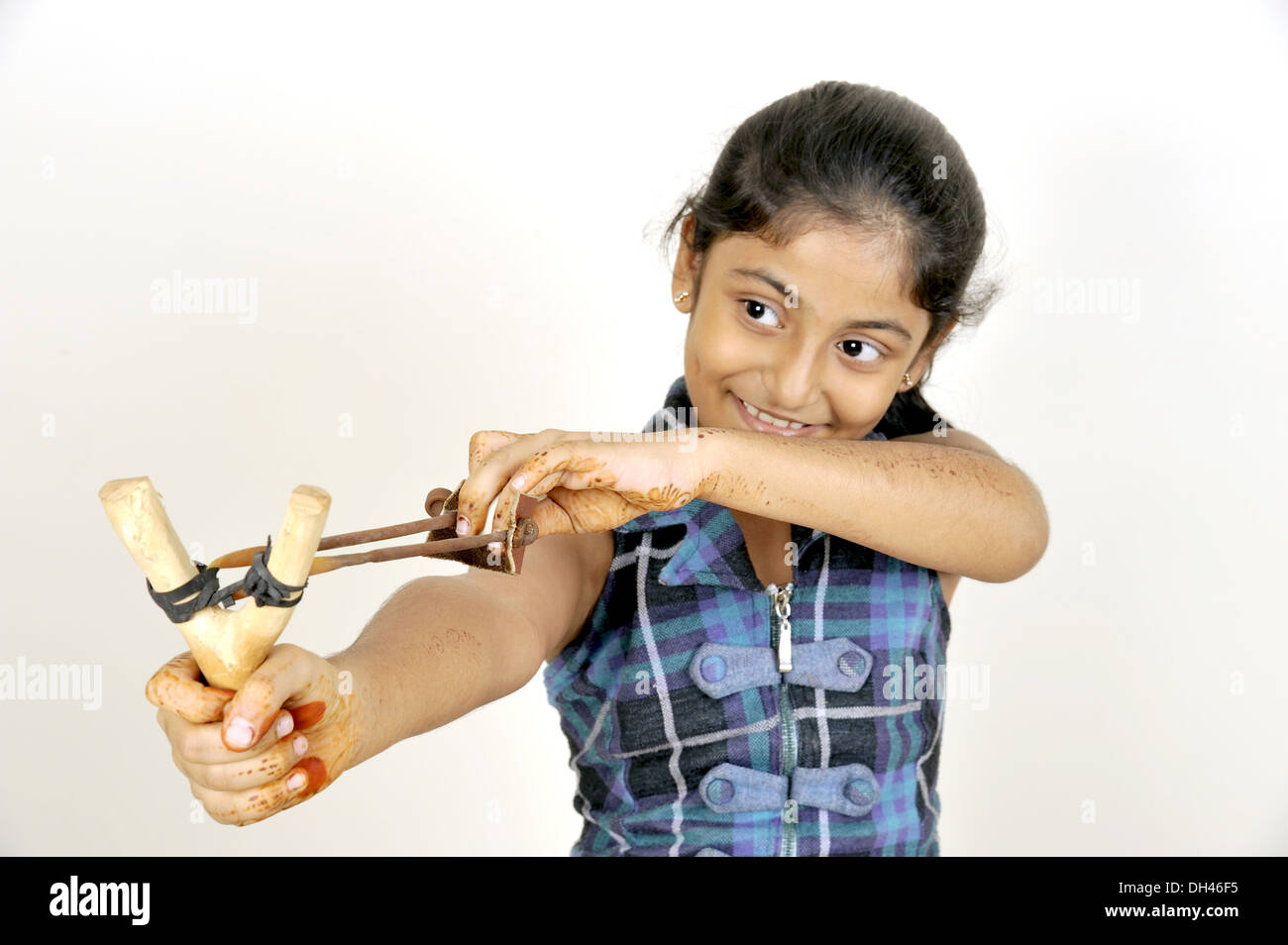 Kids Playing With Sling Shot