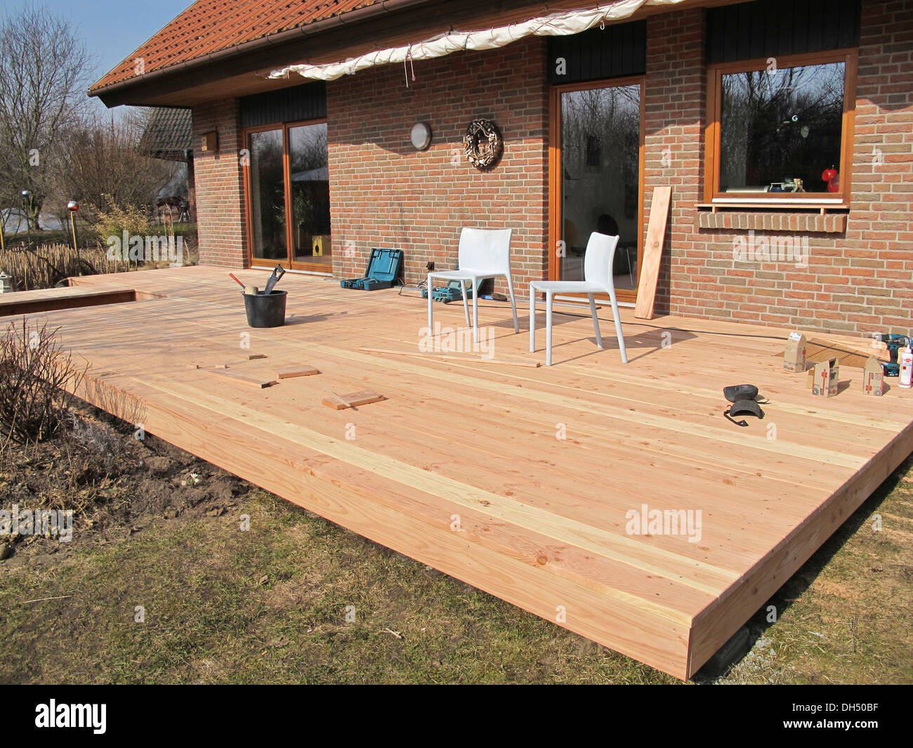 Construction of a wooden deck from douglas fir planks for Timber deck construction