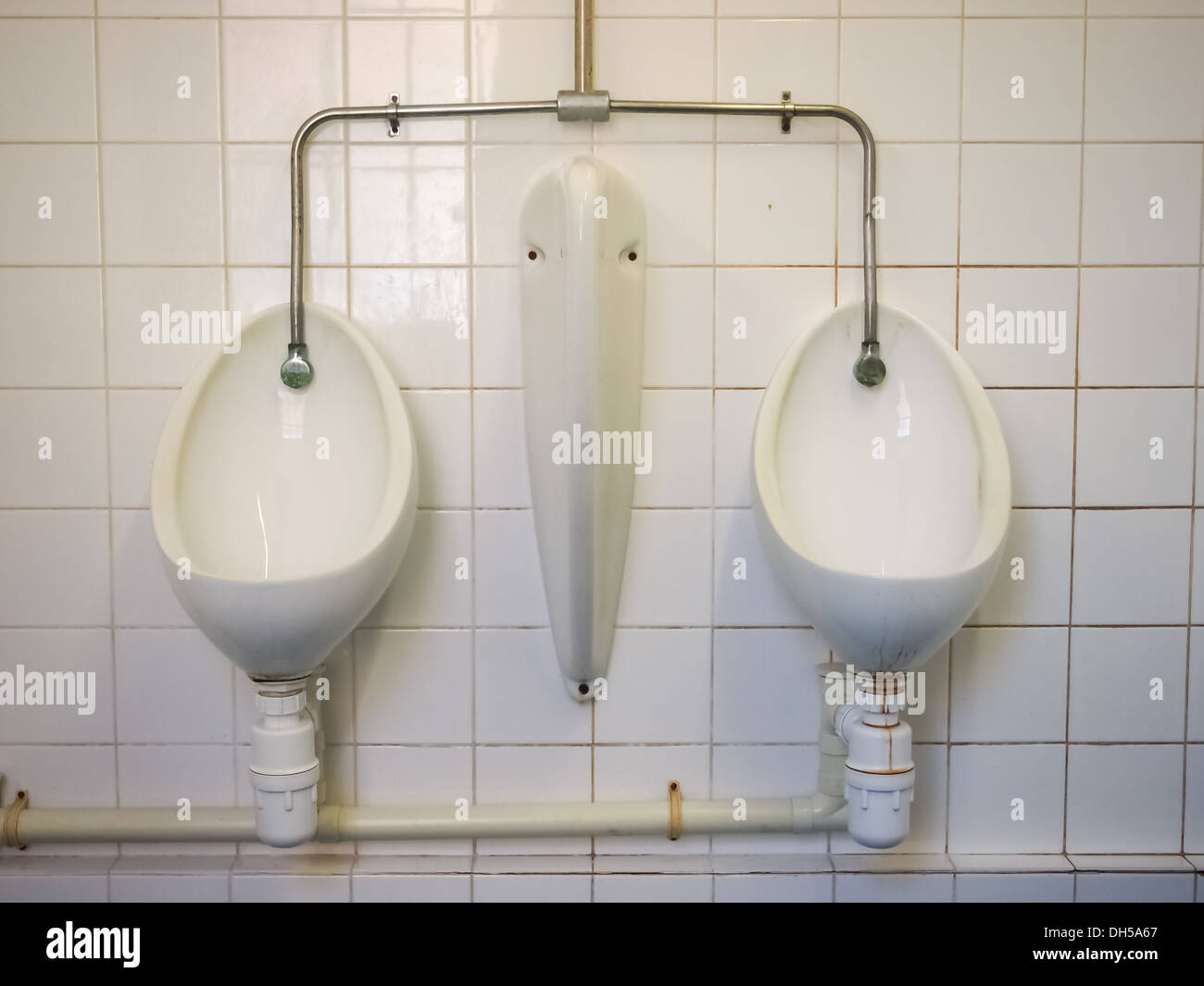 Male Urinals In A Public Bathroom With An Automated Flush System