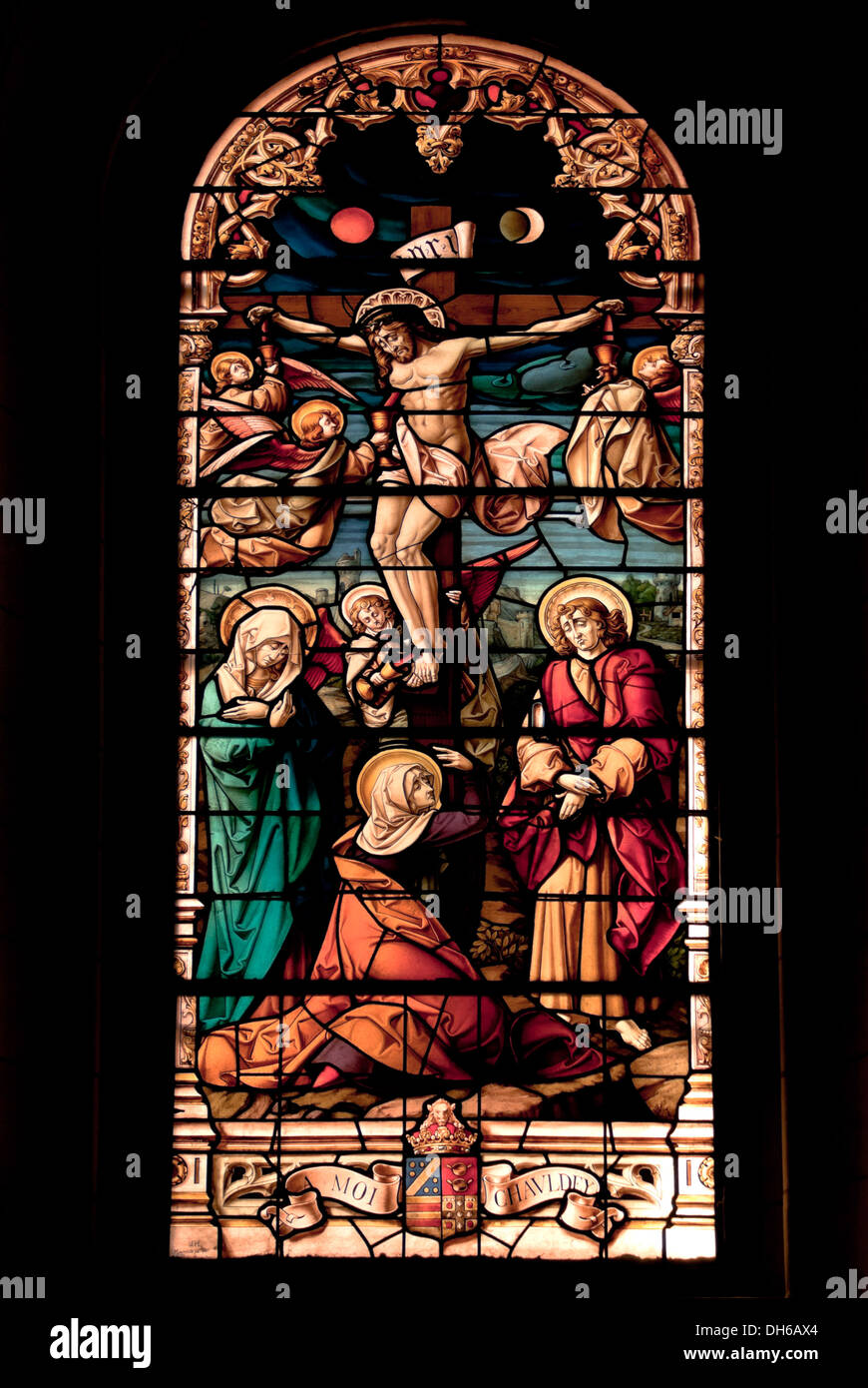 stained glass window jesus christ on the cross crucified stock
