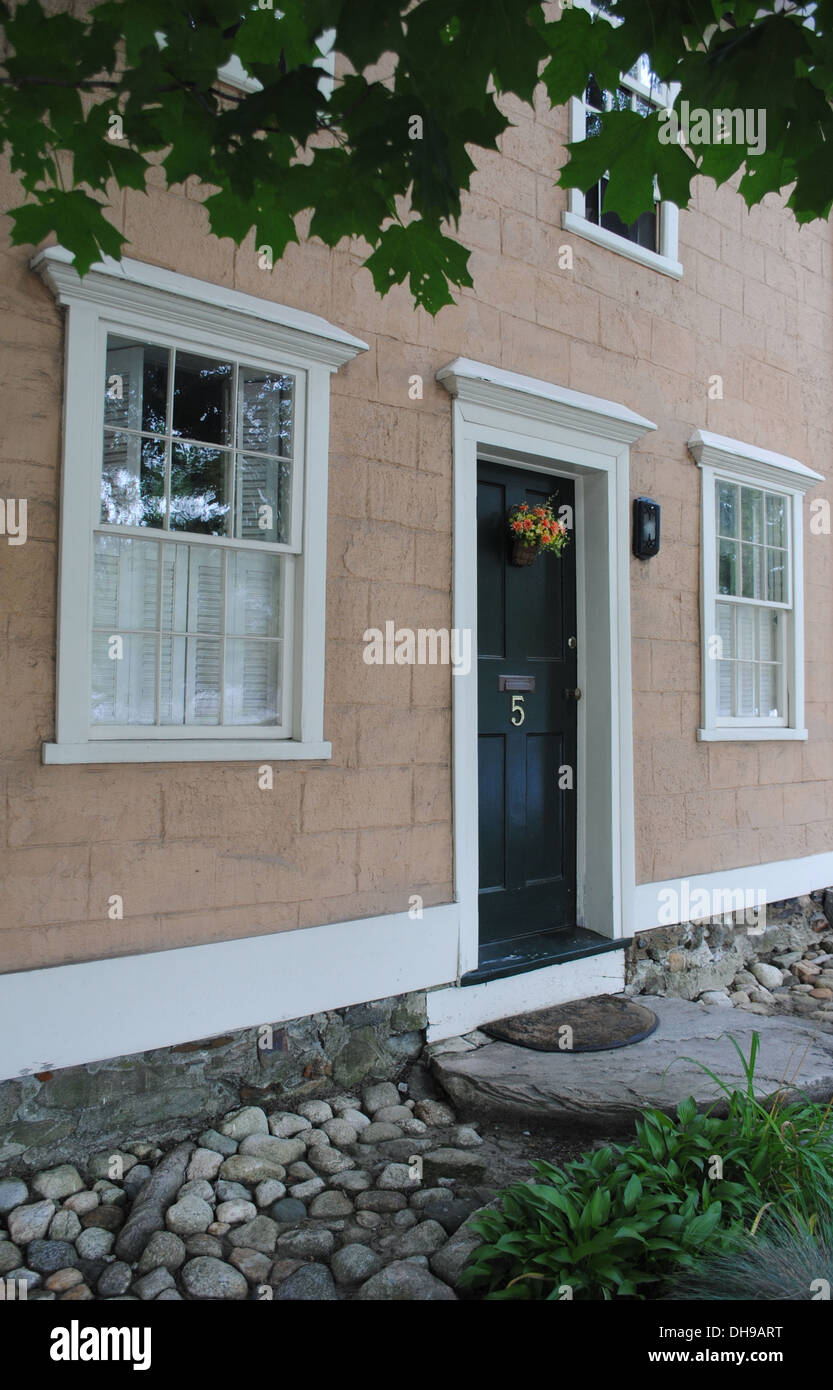 Peach House With Black Door Traditional New England