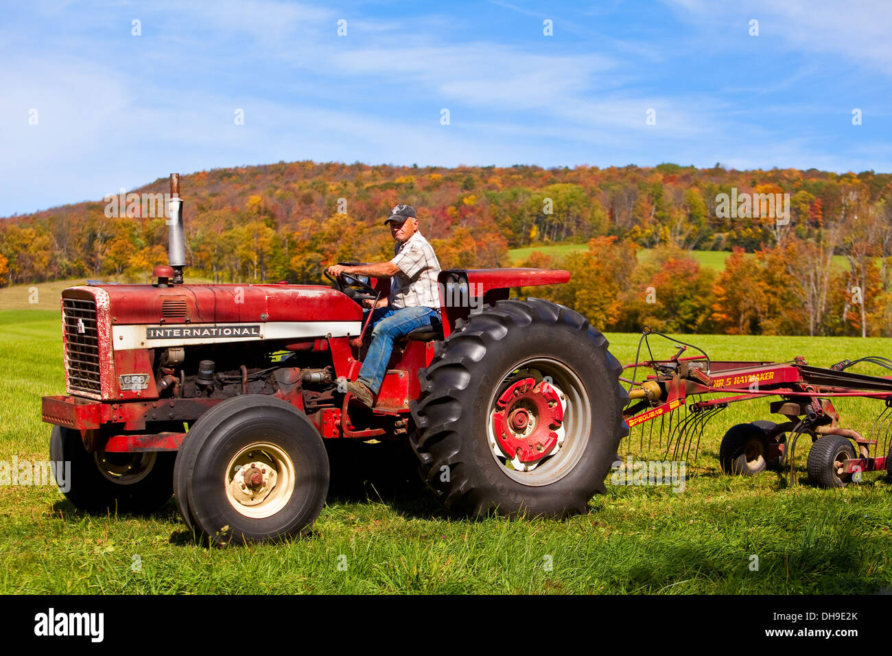Guy On Tractor : A man drives tractor on farm in berkshire county
