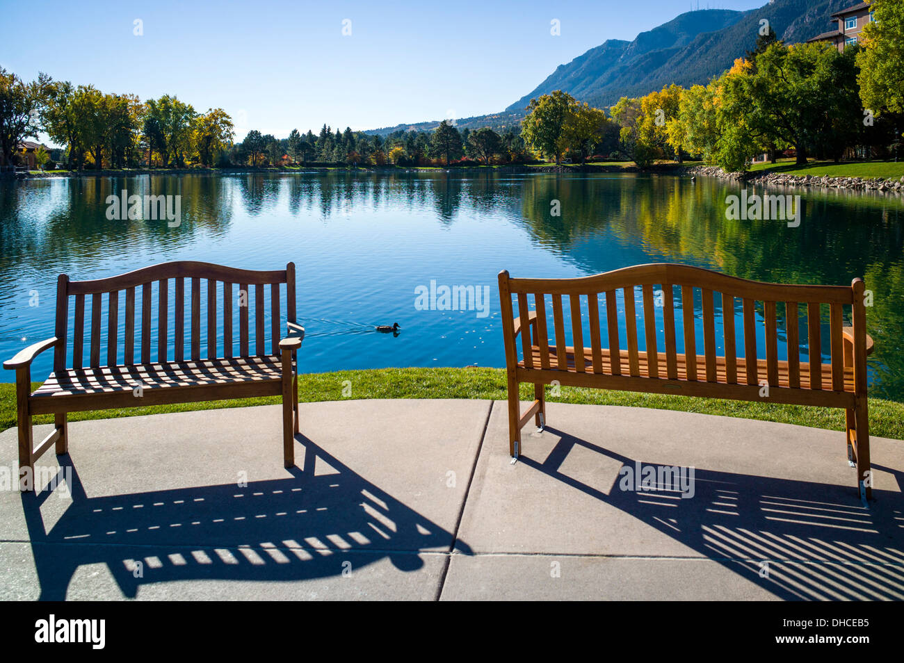 Stock photo wooden bench overlooks cheyenne lake the broodmoor historic luxury hotel and resort colorado springs colorado usa