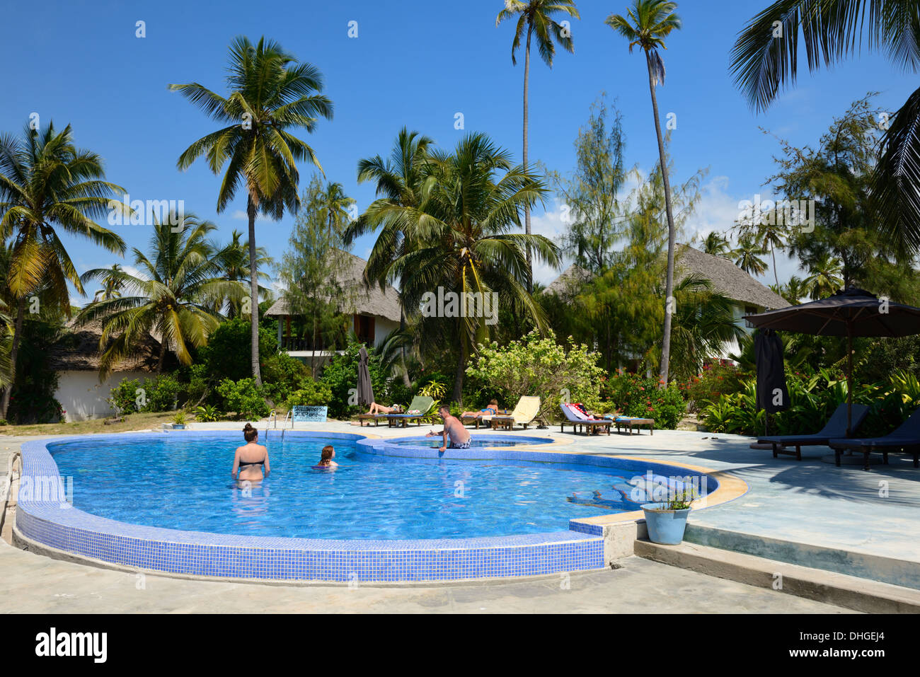 Swimming Pools At East Side : People in a swimming pool at beach side hotel bwejuu