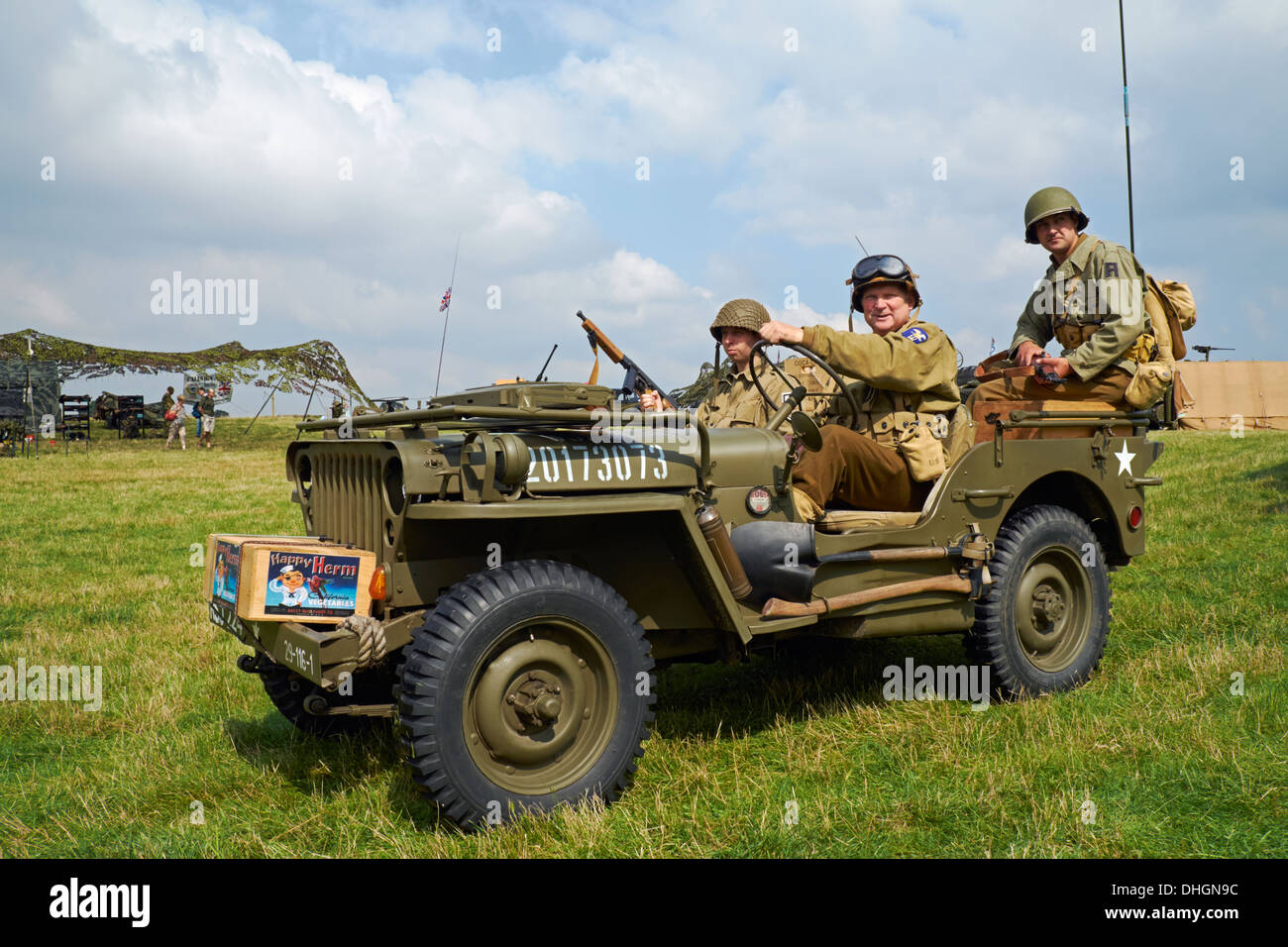 Men posing in ww2 us army uniforms in a 1943 willys mb jeep rauceby war weekend lincolnshire england