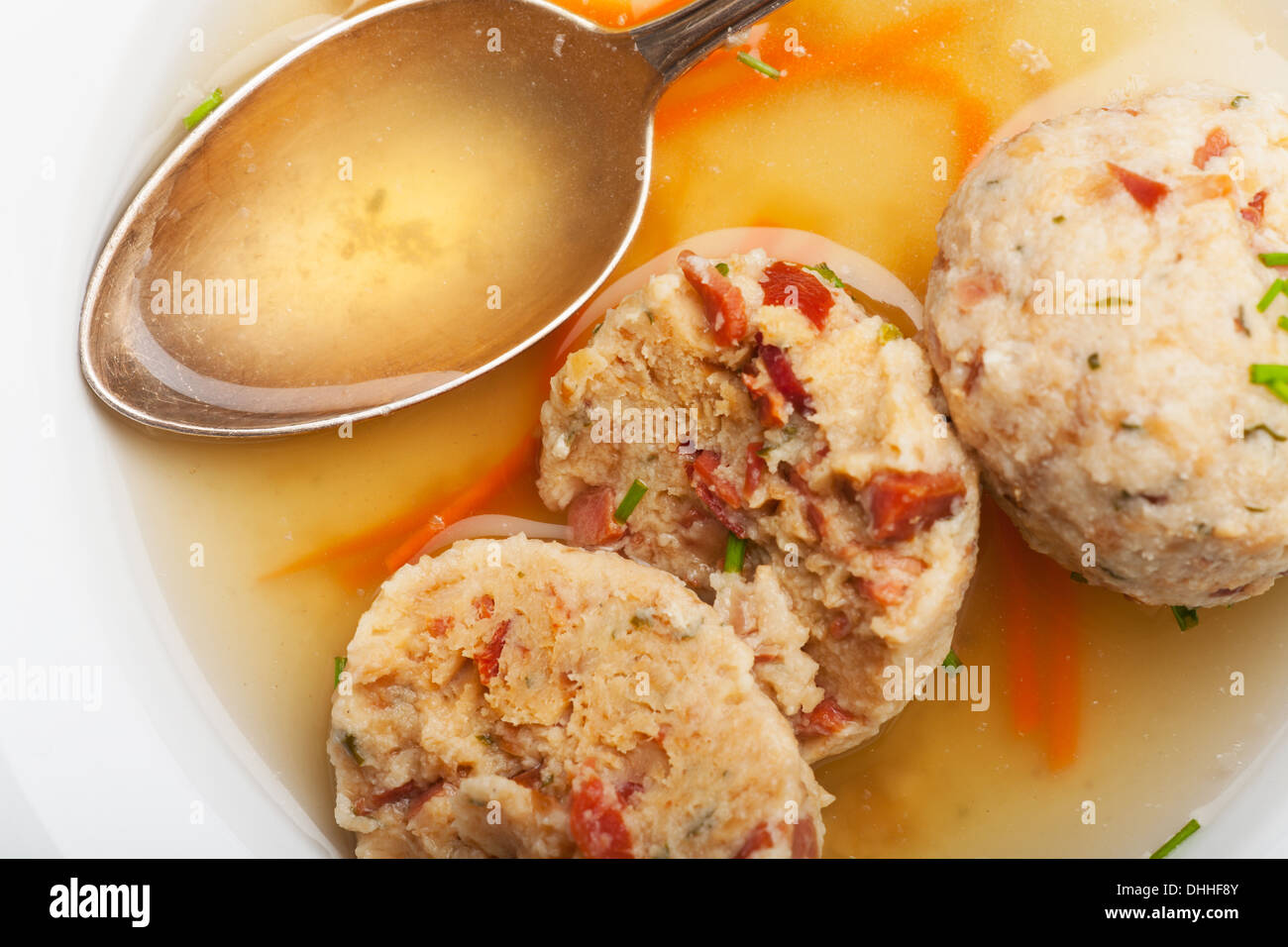 Speckknoedel a tyrolean dumpling in broth stock photo for Farcical oed