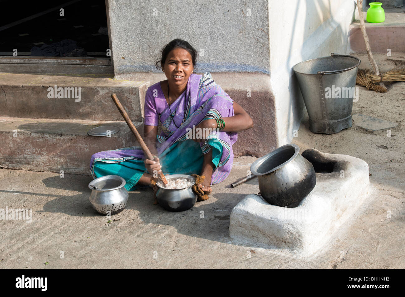http://c8.alamy.com/comp/DHHNH2/indian-woman-cooking-rice-on-an-open-fire-outside-her-home-in-a-rural-DHHNH2.jpg Indian Woman Cooking