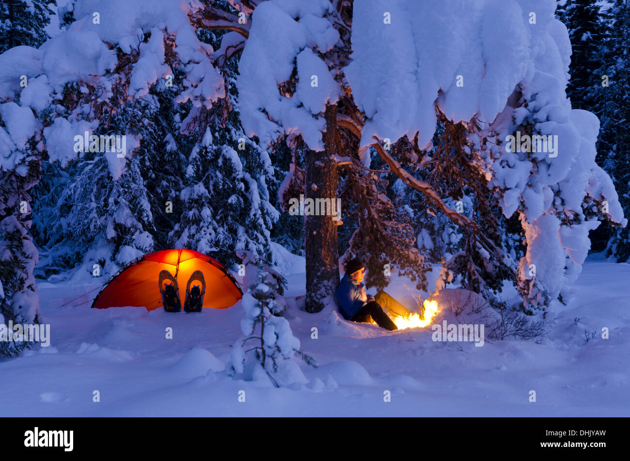 man with c&fire and tent in snow Norway & man with campfire and tent in snow Norway Stock Photo: 62496865 ...