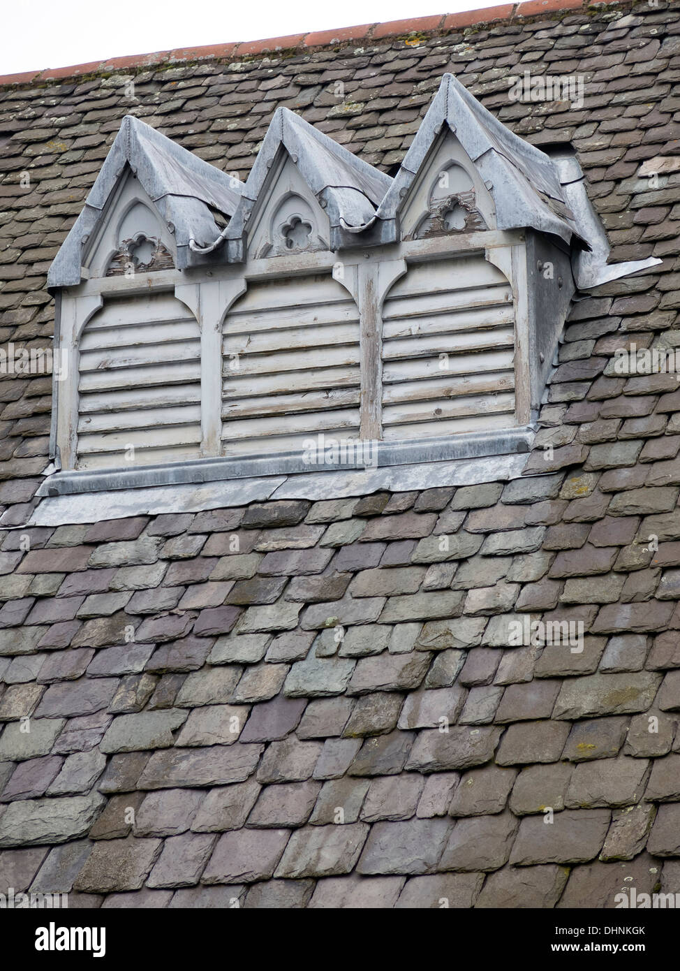 Old wooden louvered roof vents in slated tiled roof Leicester