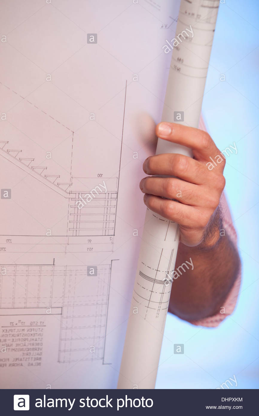 Architecture drawing rolled stock photos architecture drawing man holding blueprint architectural drawing plan stock image malvernweather Image collections