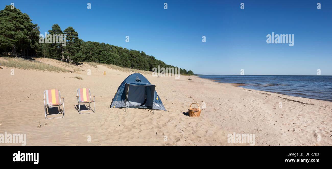 Lakeside sandy Kauksi beach with chairs picnic basket and dome tent. Lake Peipsi Ida-Viru county Estonia & Lakeside sandy Kauksi beach with chairs picnic basket and dome ...