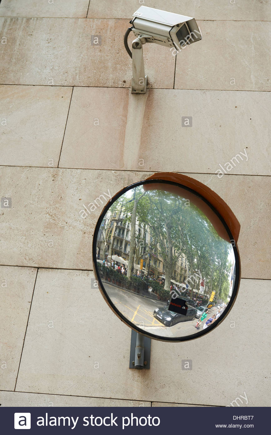 Surveilance camera and mirror on a wall on la rambla street in the surveilance camera and mirror on a wall on la rambla street in the city of barcelona in catalunya in spain in europe amipublicfo Gallery