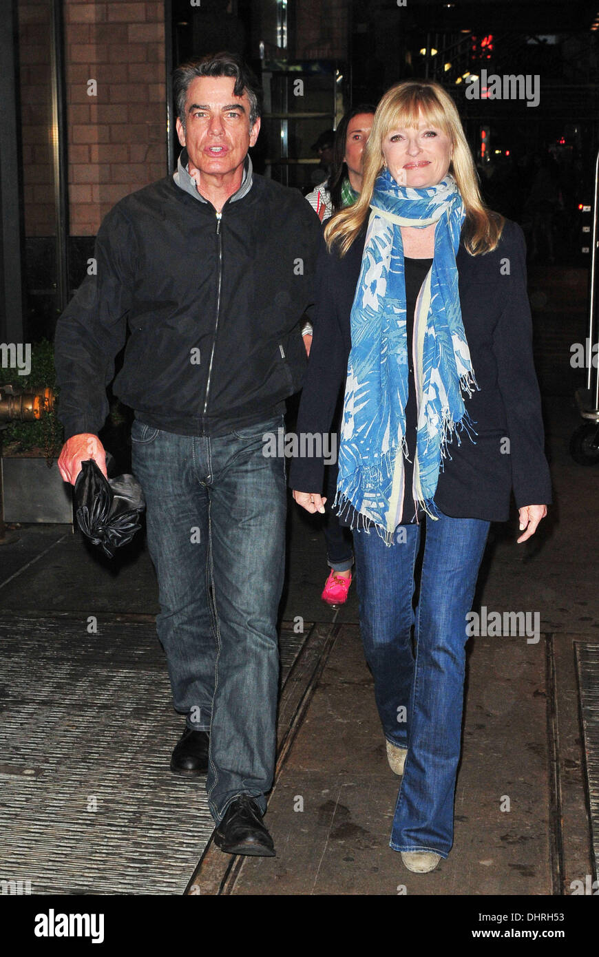 peter gallagher and wife paula harwood outside their