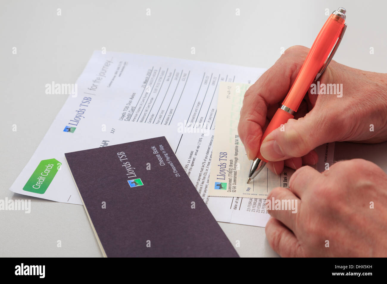 Lloyds bank debit card stock photos lloyds bank debit card stock senior woman pensioner writing a lloyds tsb bank cheque to pay a large credit card bill magicingreecefo Image collections