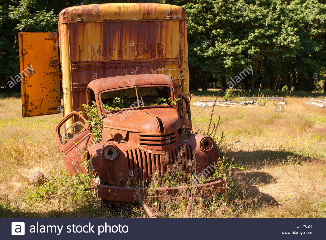 Old rusted out box truck abandoned in a field Stock Photo: 62677724 ...