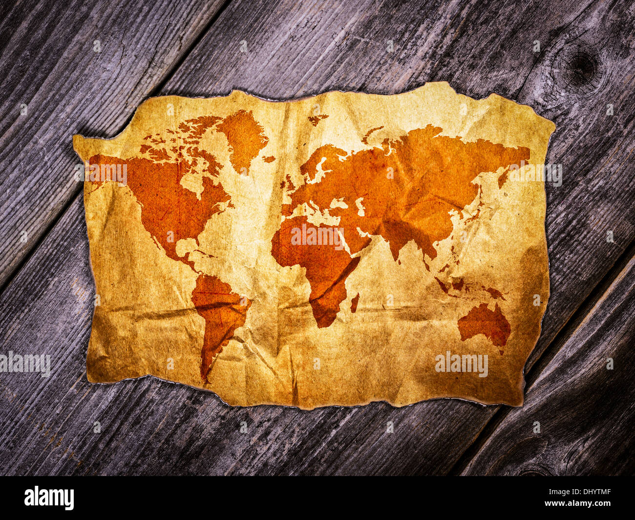 Old world map over wooden background stock photo royalty free image old world map over wooden background gumiabroncs Images