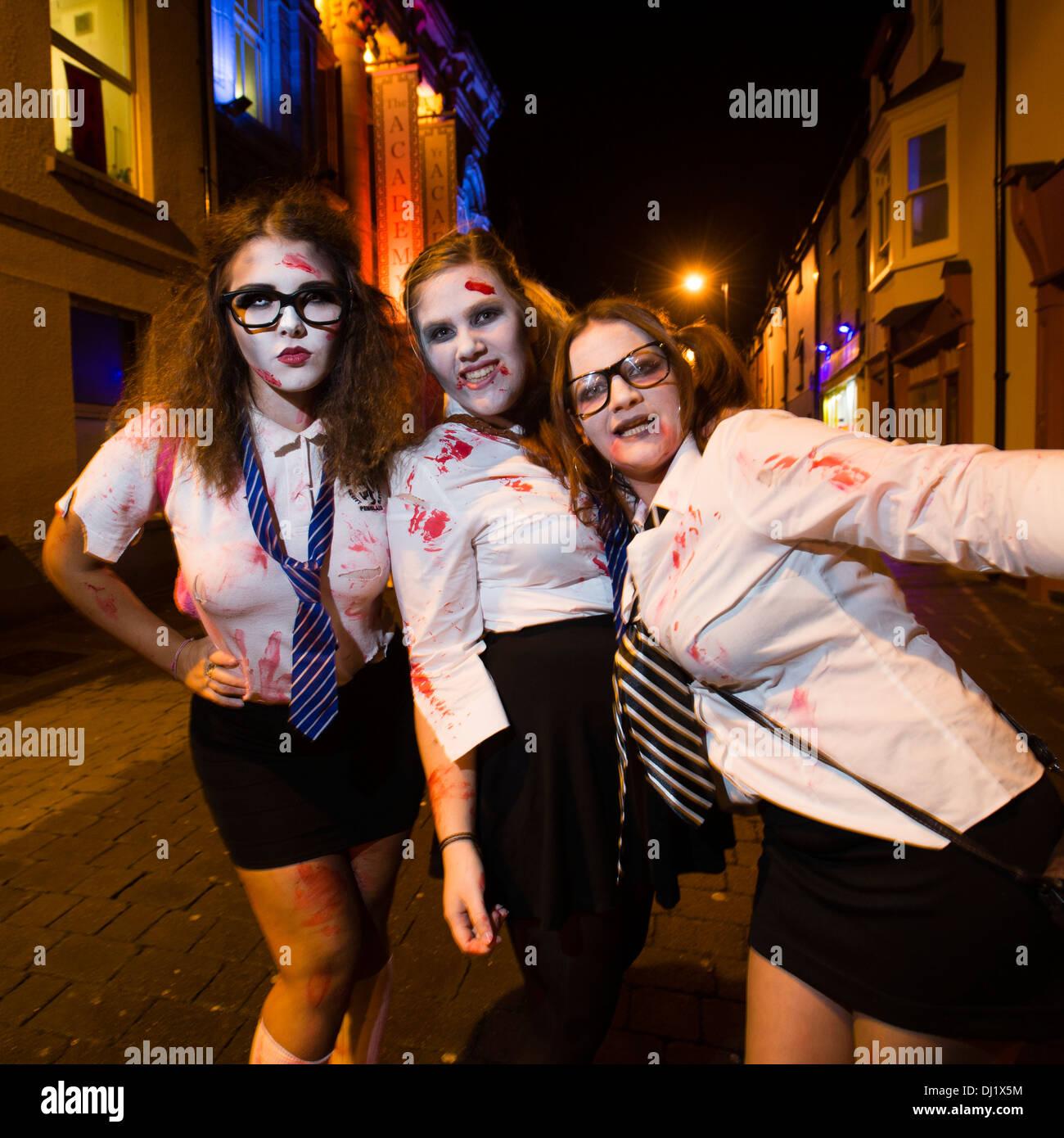 Three Young women, university students, in fancy dress schoolgirl ...