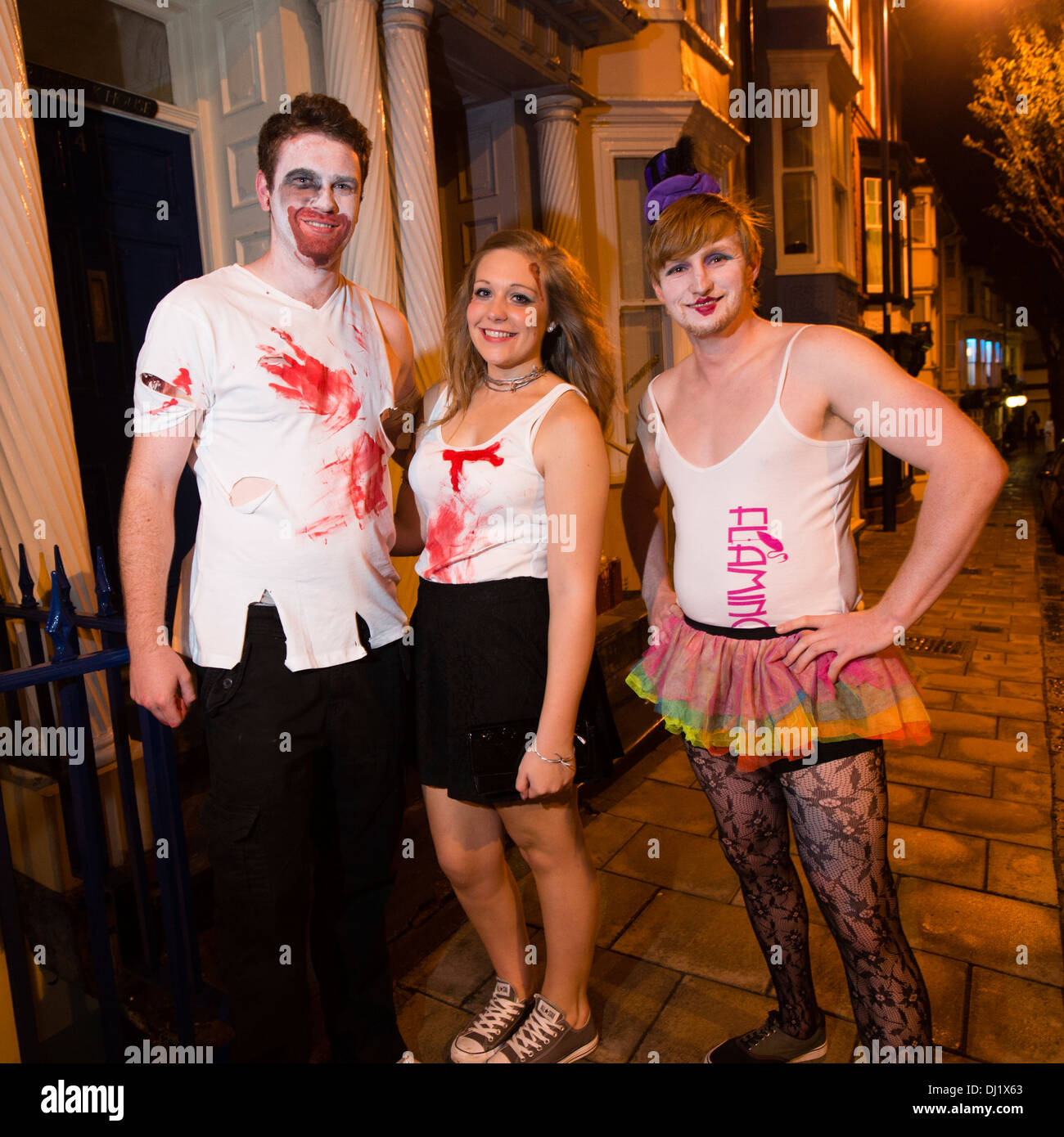 Three Young People, university students, in fancy dress costumes ...