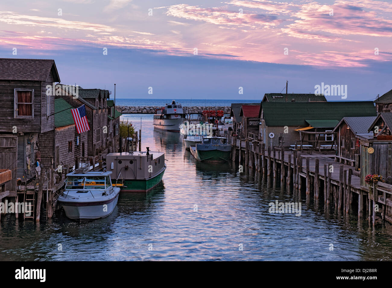 Sunset Over Lake Michigan And Historic Fishtown In Leland