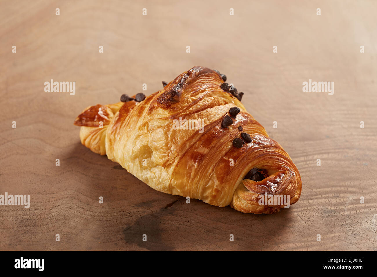 French butter and chocolate croissant on wooden table Stock Photo ...