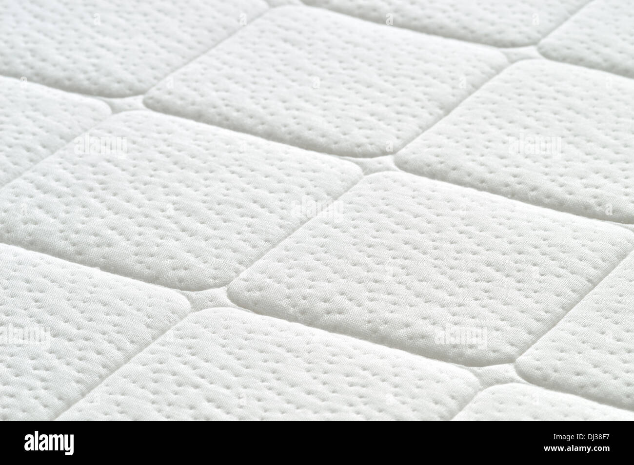 mattress texture. Close-up Of White Mattress Texture. Patter Quilted Material. Comfortable Mattress. Copy Space Texture