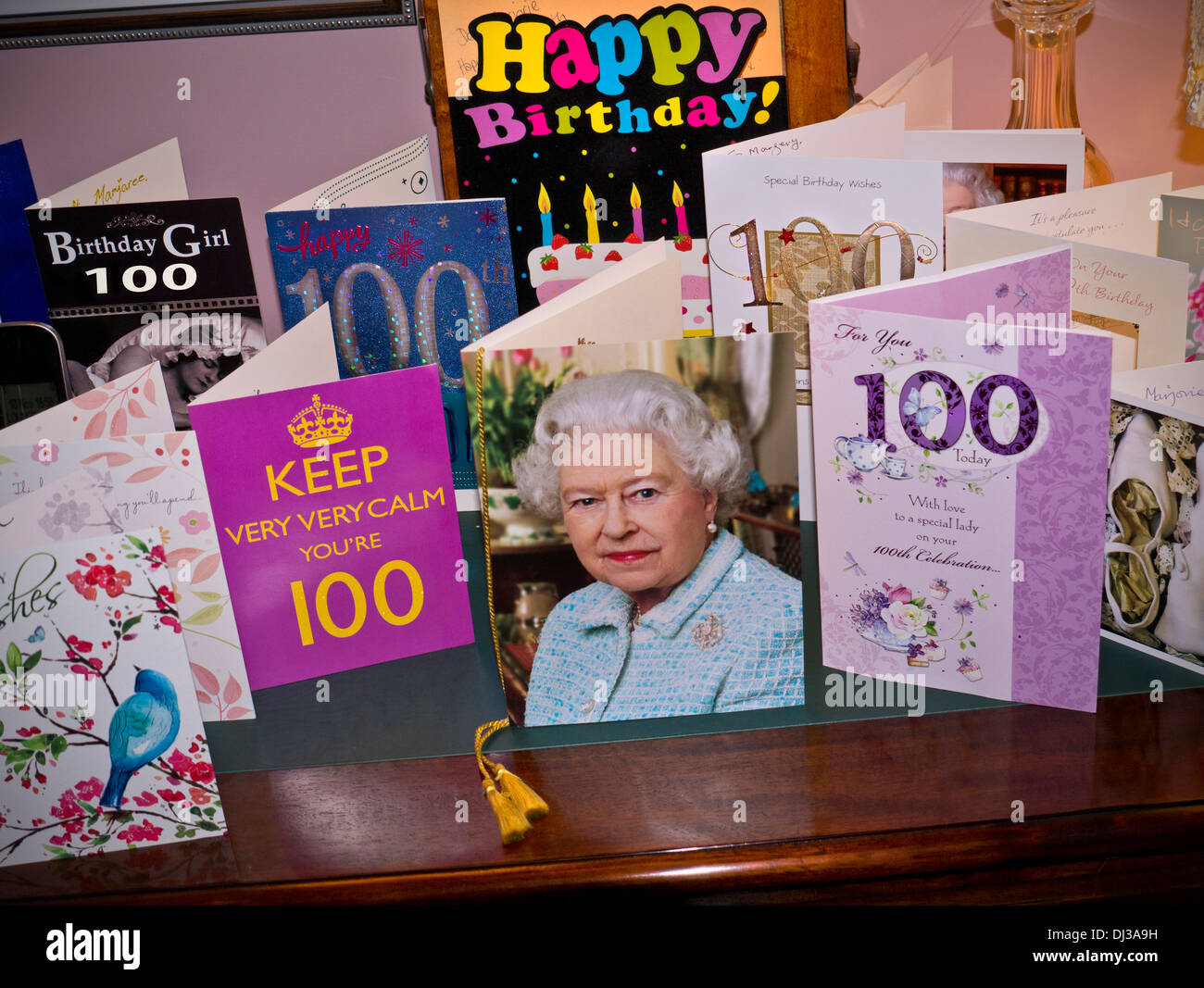 Selection of 100 years of age birthday cards on sideboard with the selection of 100 years of age birthday cards on sideboard with the traditional card from hrh queen elizabeth 11 in centre place bookmarktalkfo Images