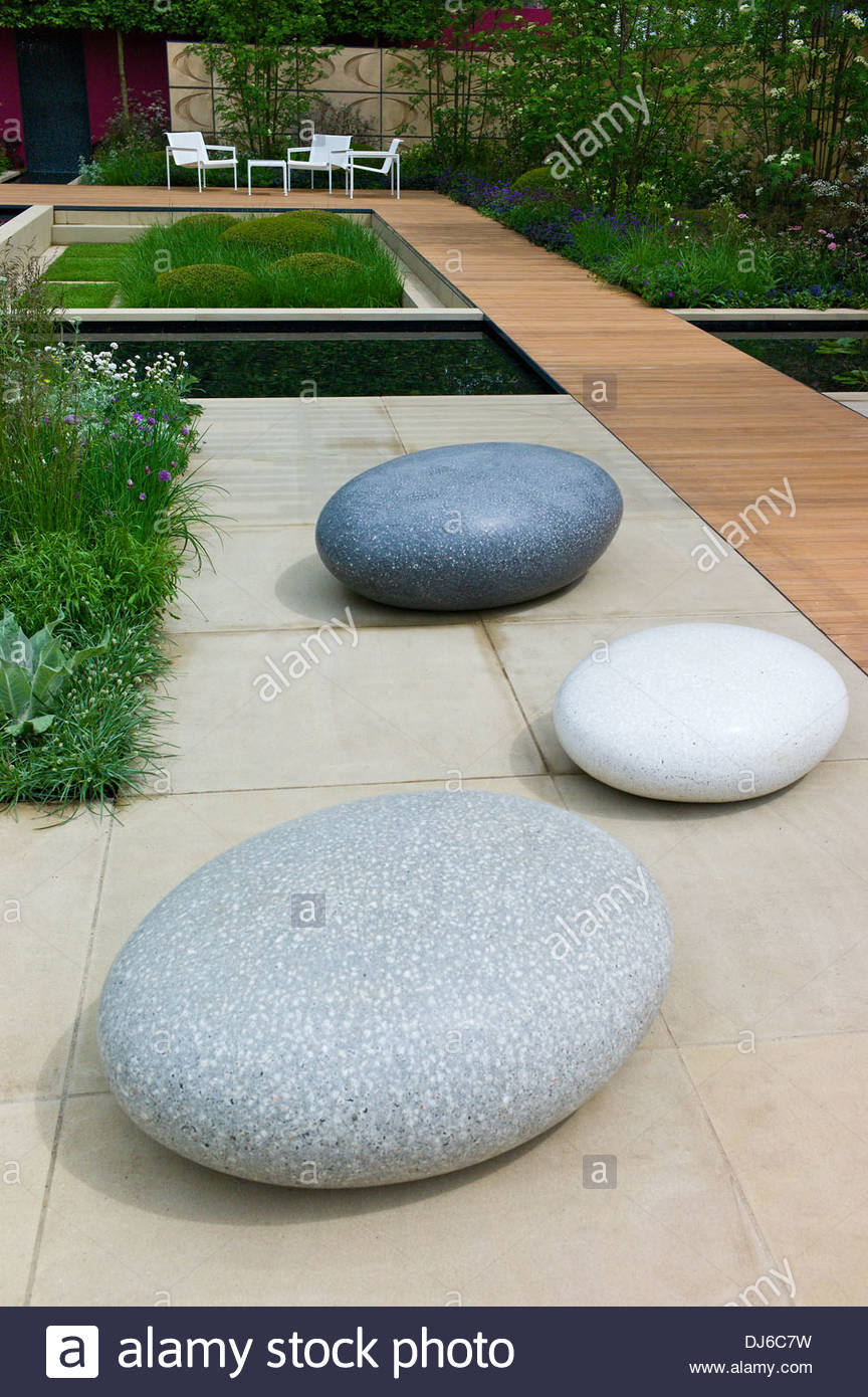 large sculptural stone pebbles in a contemporary garden. Black Bedroom Furniture Sets. Home Design Ideas