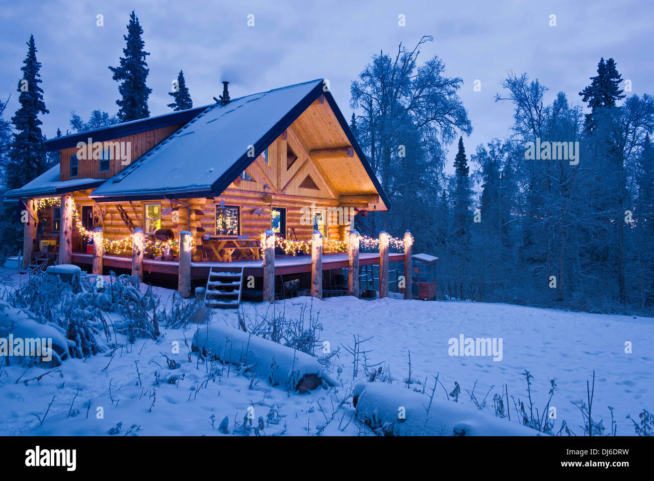 Log cabin in the woods winter - Log Cabin In The Woods Decorated With Christmas Lights At Twilight Near Fairbanks Alaska During Winter