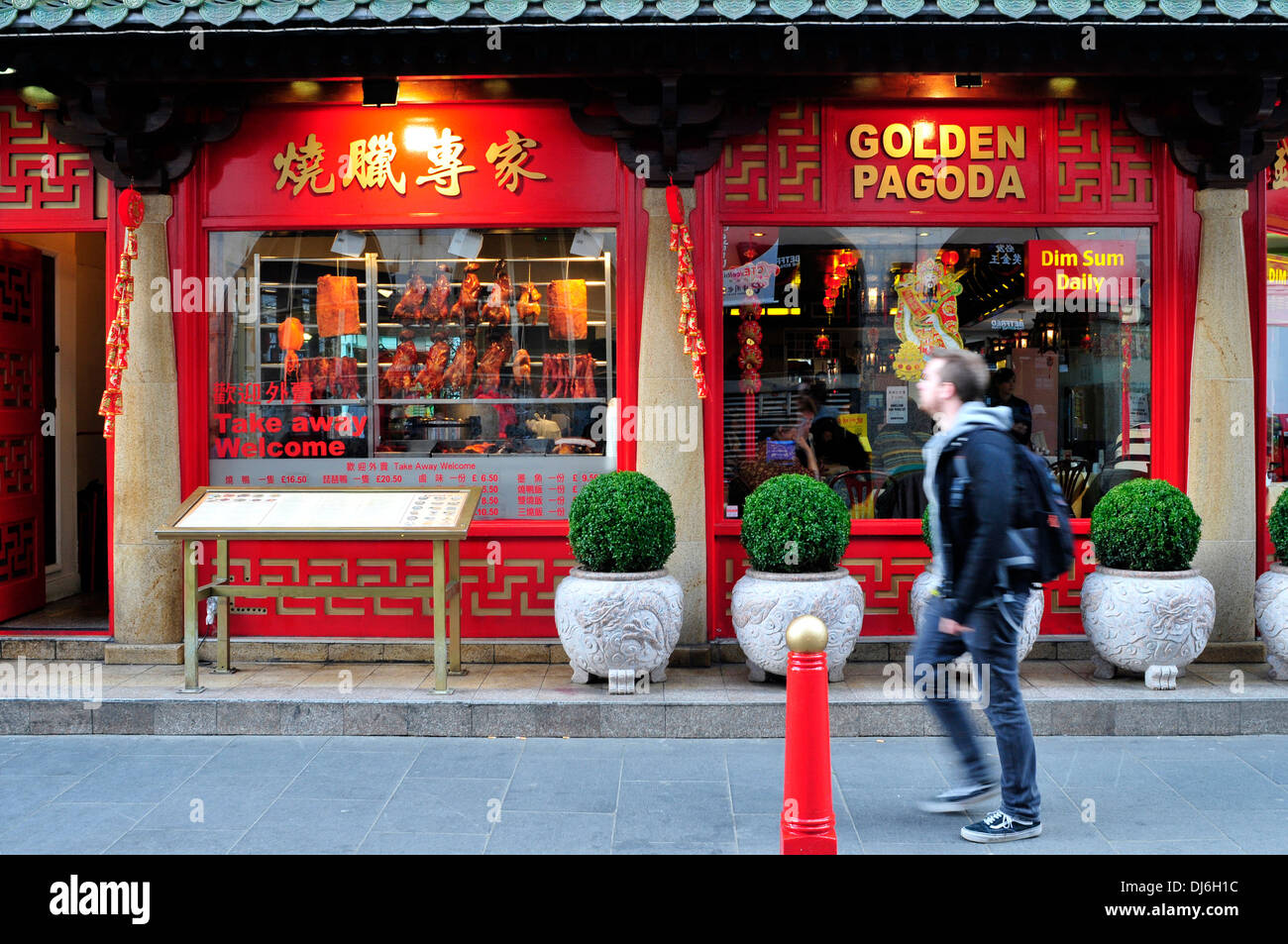 a man walks past the golden pagoda restaurant in china town london stock photo royalty free. Black Bedroom Furniture Sets. Home Design Ideas
