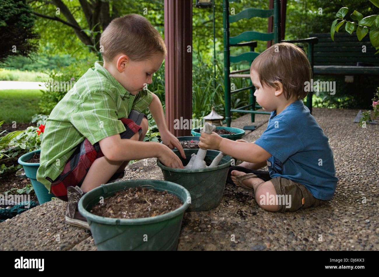Five year old and two year old boys playing with soil and for Gardening tools for 6 year old