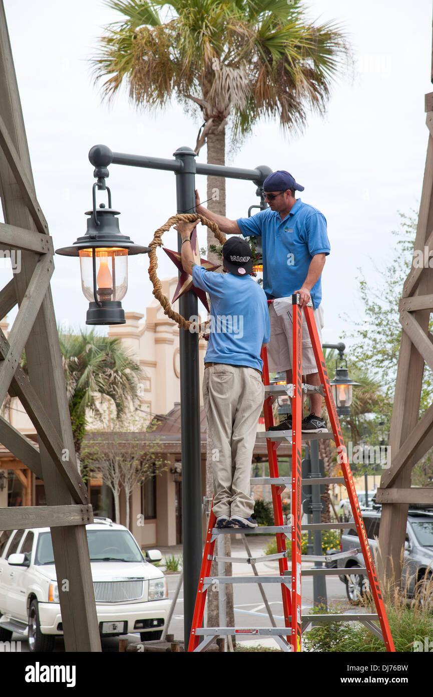 Brownwood The Villages Florida USA Men using a ladder to put up ...