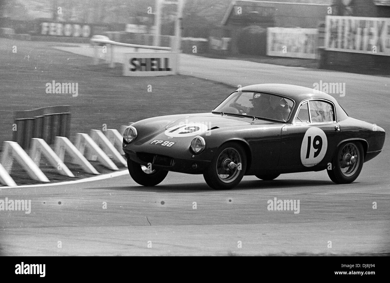 a lotus elite racing into tatts corner in the aintree 200 race england 30 april