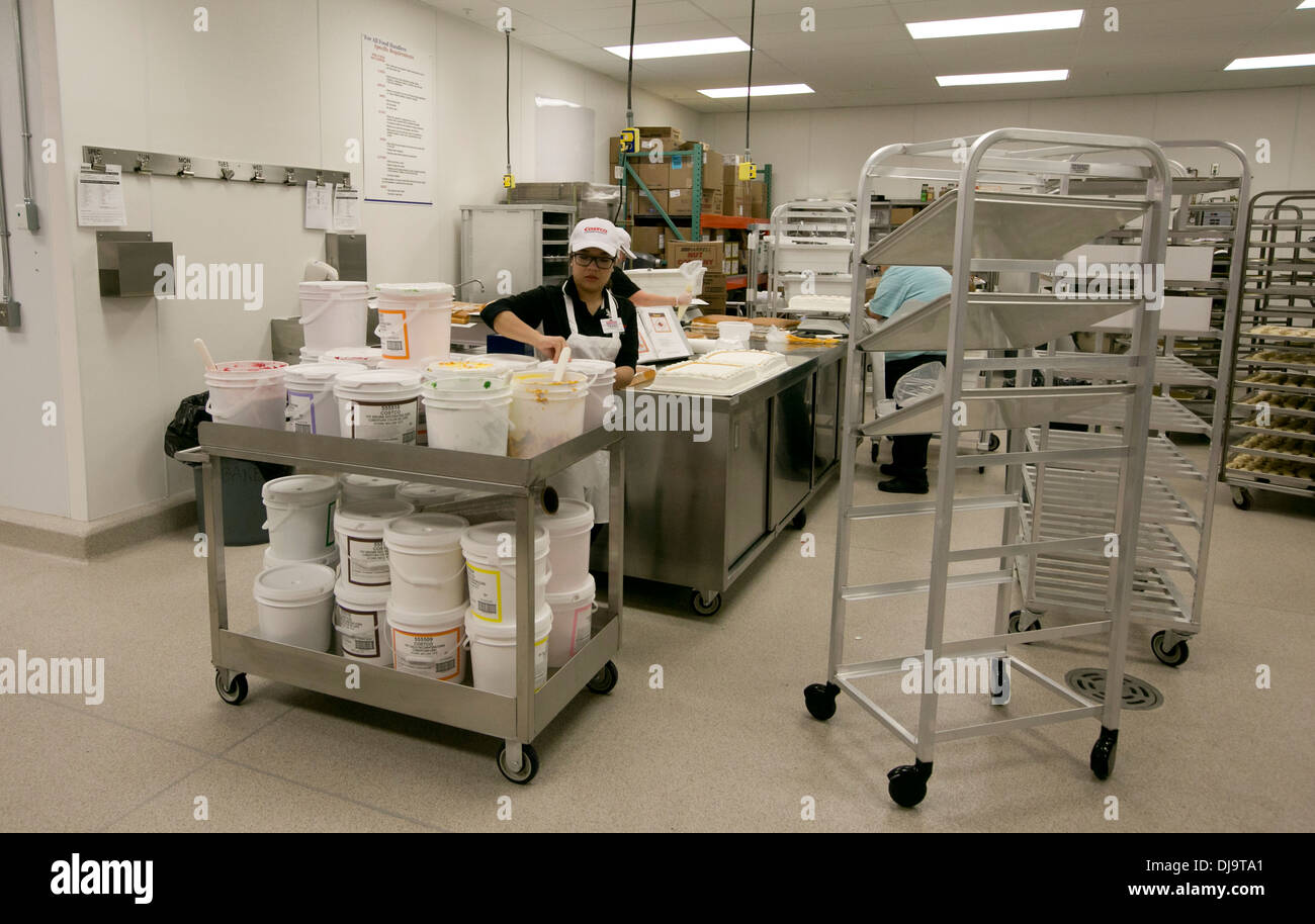 costco and employee stock photos costco and employee stock costco warehouse employees working at in house bakery at newly open store in cedar park