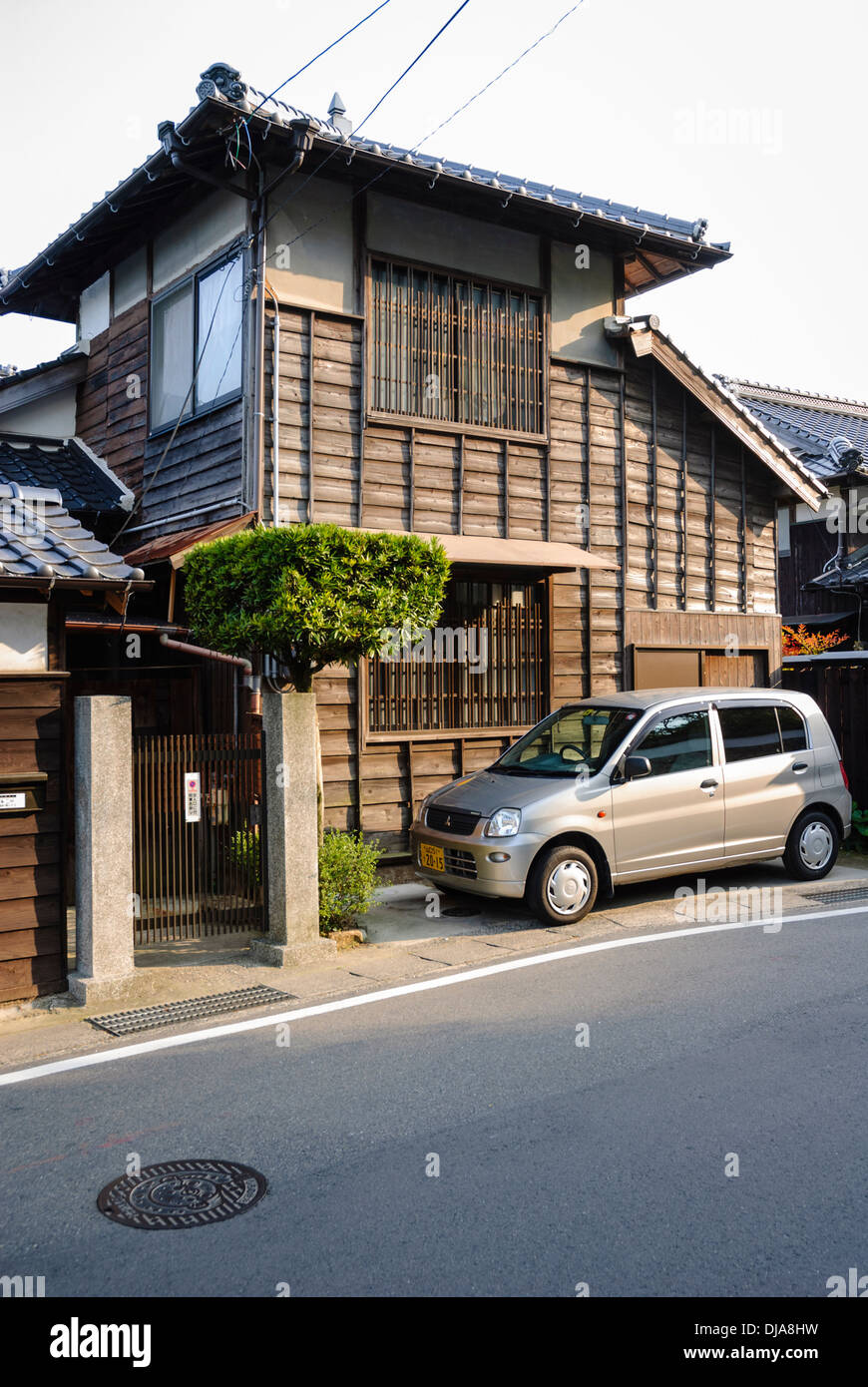Traditional compact japanese home wooden house in japan with very small parking space and