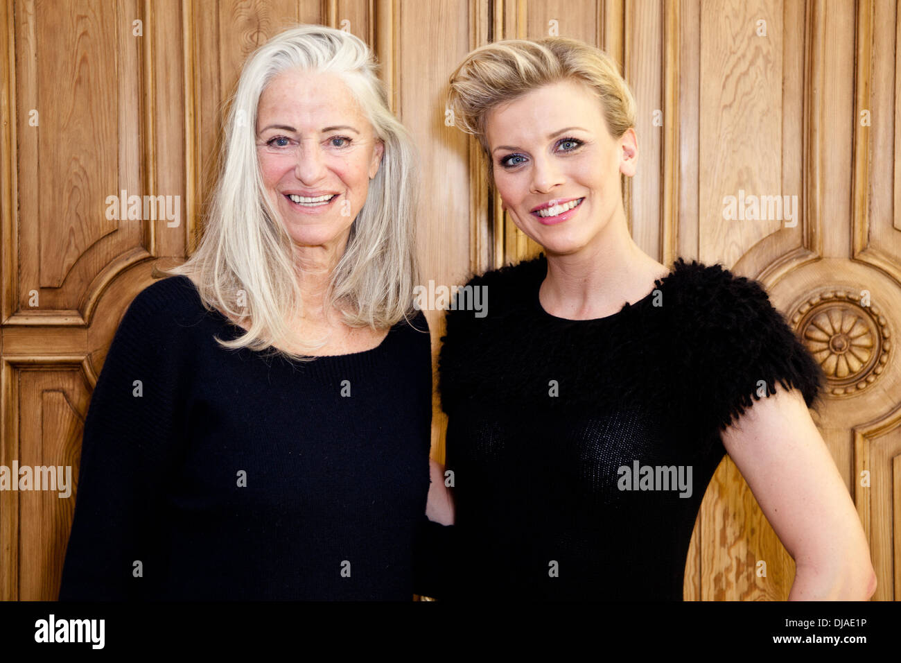 iris von arnim and eva habermann fitting for the charity fashion show stock photo royalty free. Black Bedroom Furniture Sets. Home Design Ideas