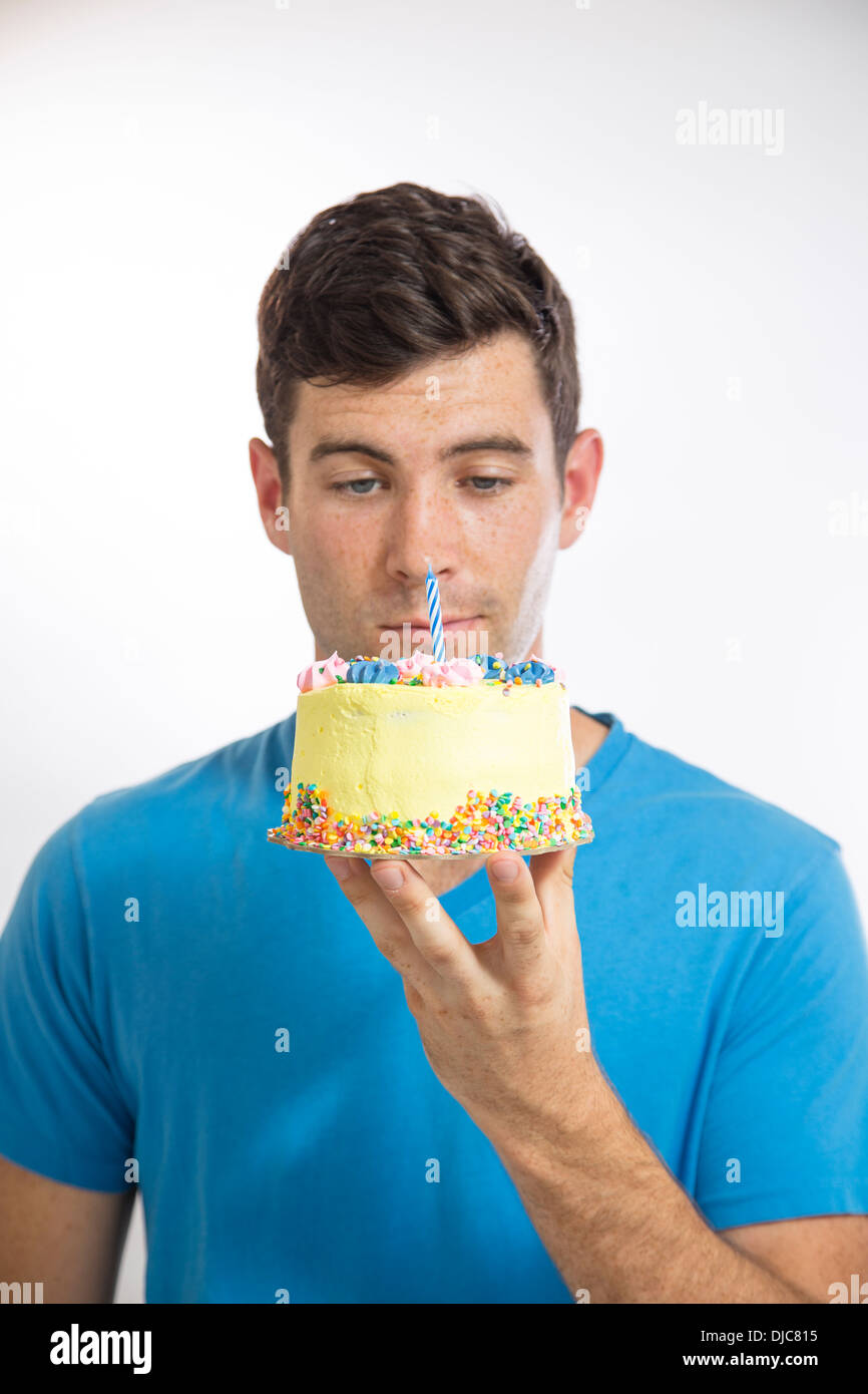 Young man holding a birthday cake Stock Photo Royalty Free Image