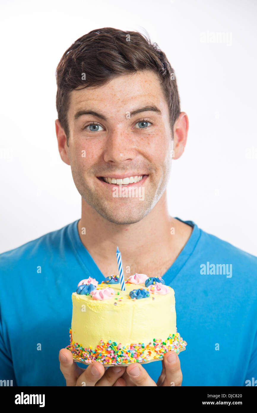 Young man holding birthday cake Stock Photo Royalty Free Image