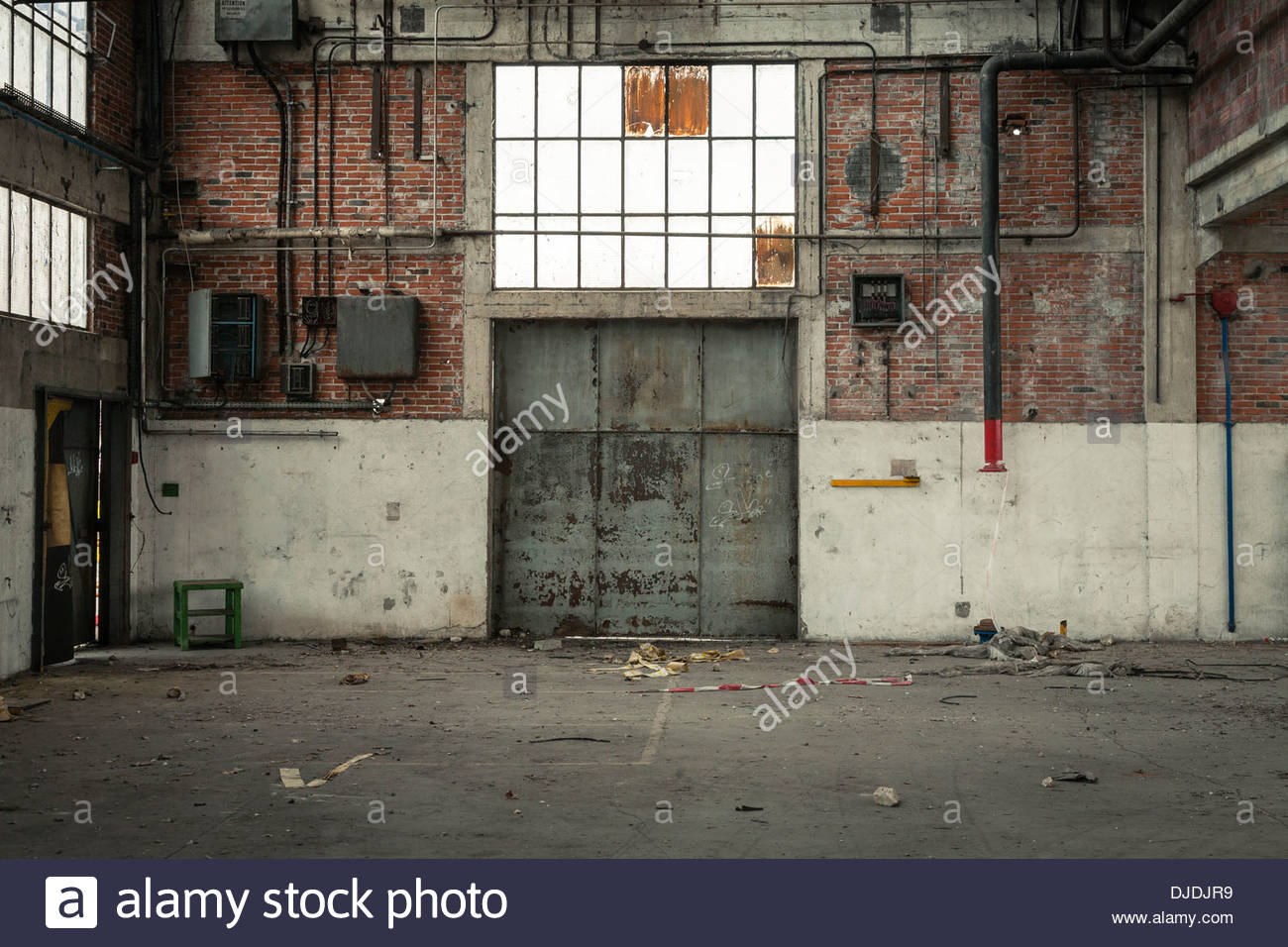 Damaged garage door stock photos damaged garage door stock large metal door inside of abandoned factory montluon allier department auvergne france rubansaba