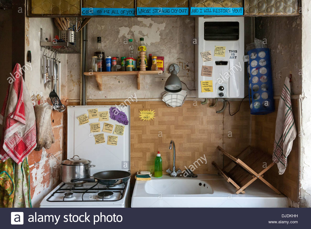 Small Old Kitchen a small messy kitchen in an old french farmhouse stock photo