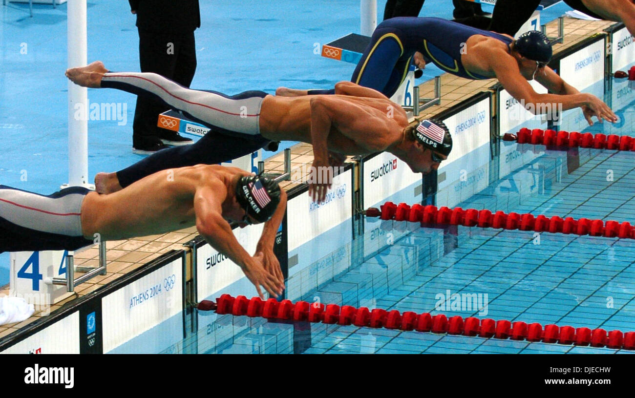 aug 20 2004 athens greece olympic swimmers ian croker michael phelps and andriy serdinov push off the starting blocks friday aug 20 2004 in athens