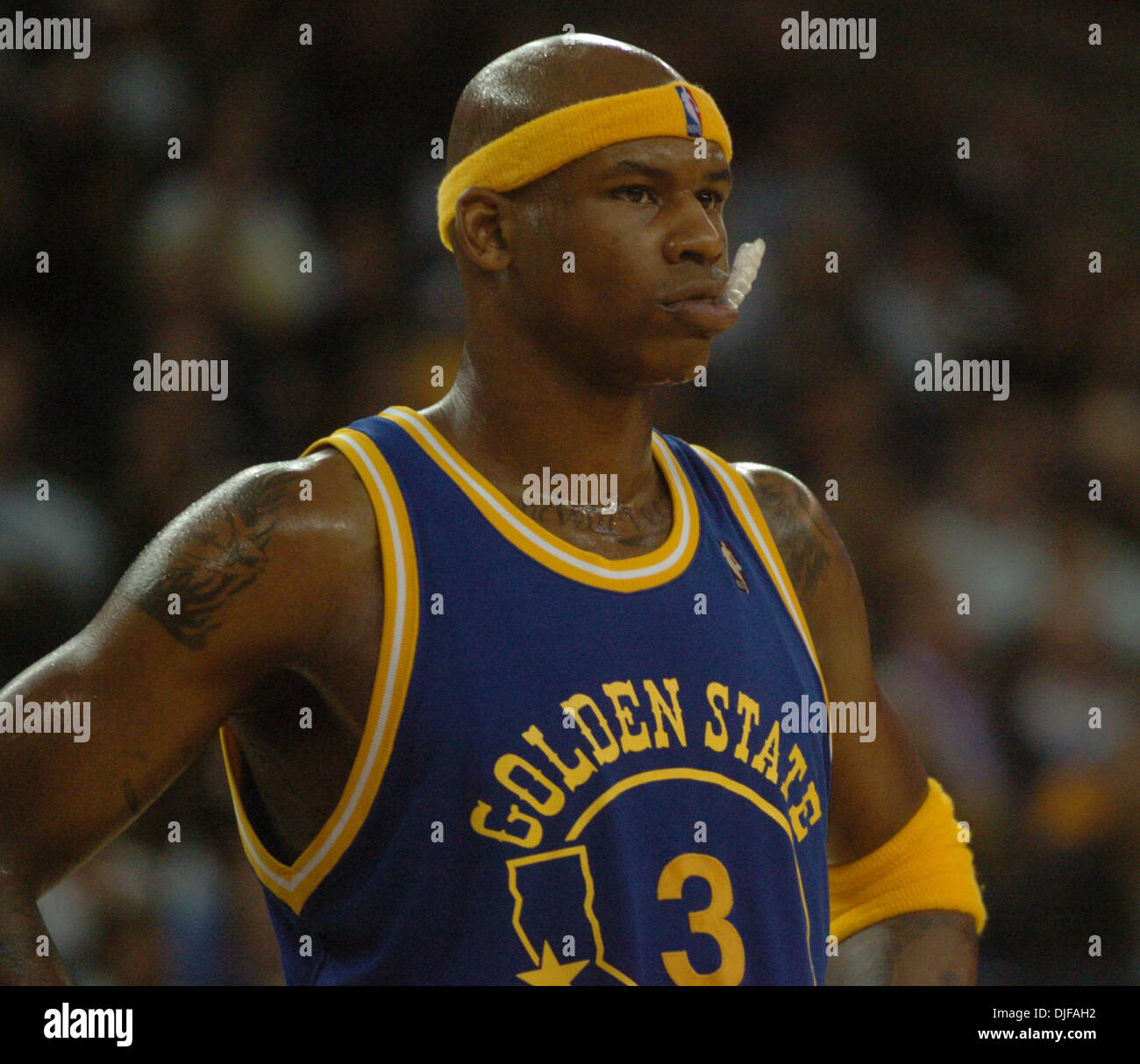 Golden State Warriors Al Harrington plays with his mouth guard in