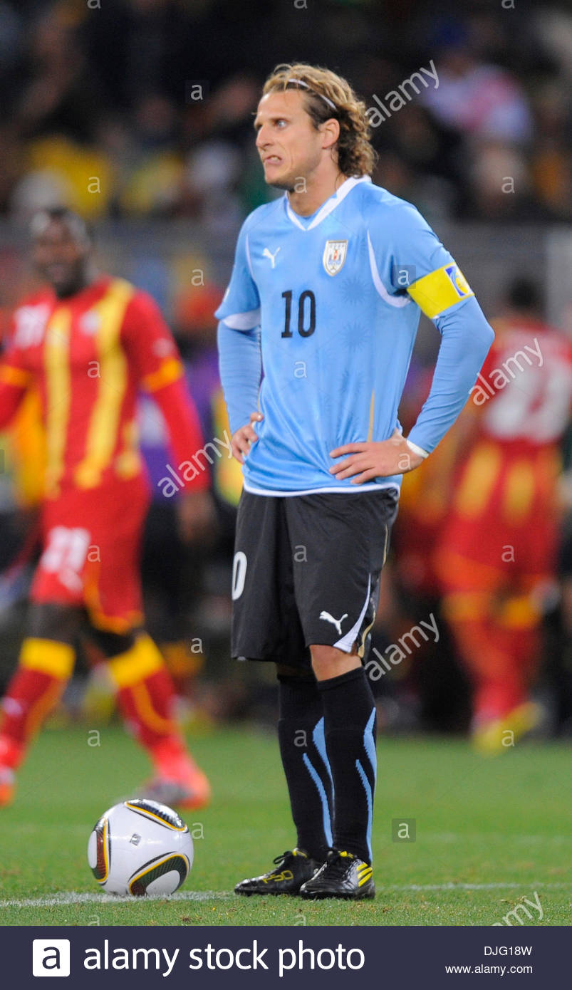 Diego Forlan of Uruguay stands dejected after conceding a goal in