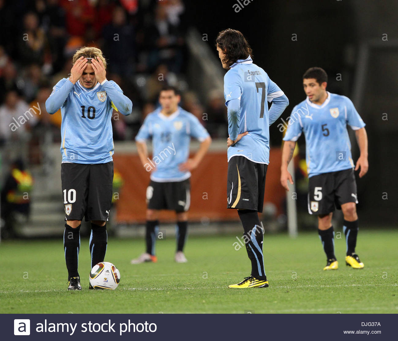 Uruguay s Diego Forlan looks on dejected after going 3 1 down