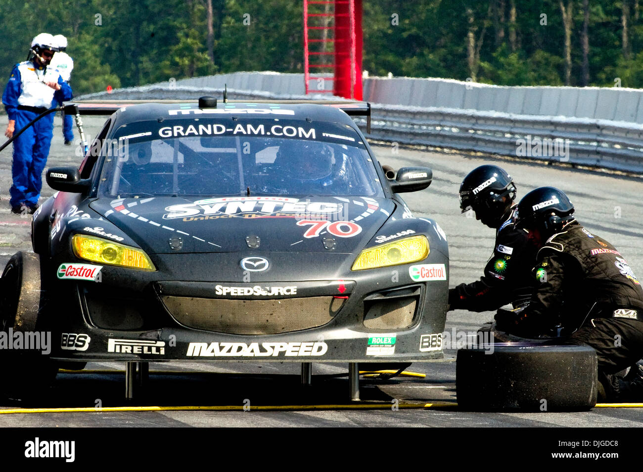Stock photo the 70 speed source grand touring gt car during a pit stop during the njmp 250 presented by crown royal at the new jersey motorsports